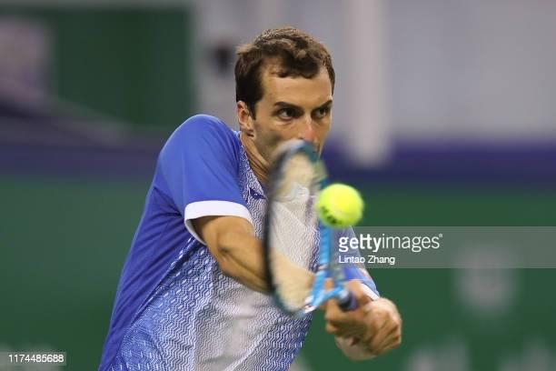 Albert Ramos-Vinolas of Spain returns a shot against Roger Federer of Switzerland on day four of 2019 Rolex Shanghai Masters at Qi Zhong Tennis...