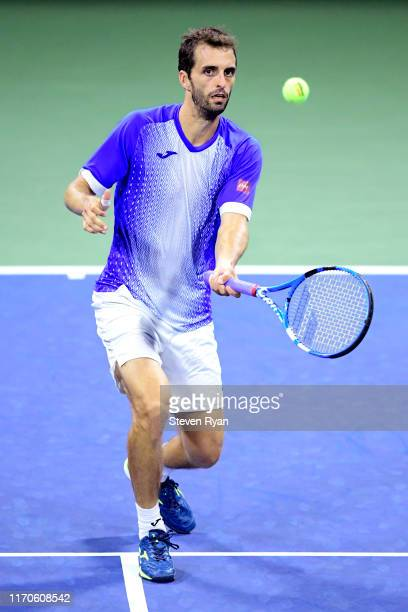 Albert Ramos-Vinolas of Spain returns a shot during his Men's Singles first round match against Gael Monfils of France on day two of the 2019 US Open...