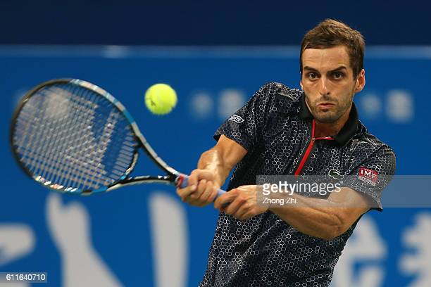 Albert RamosVinolas of Spain returns a shot during the match against Dominic Thiem of Austria during Day 5 of 2016 ATP Chengdu Open at Sichuan...