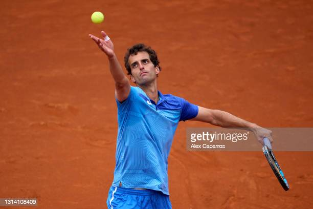 Albert Ramos-Vinolas of Spain serves against Andrey Rublev of Russia in their third round match during day four of the Barcelona Open Banc Sabadell...