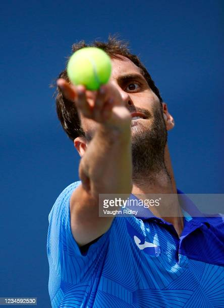 Albert Ramos-Vinolas of Spain serves against Marin Cilic of Croatia during the first round on Day One of the National Bank Open at Aviva Centre on...