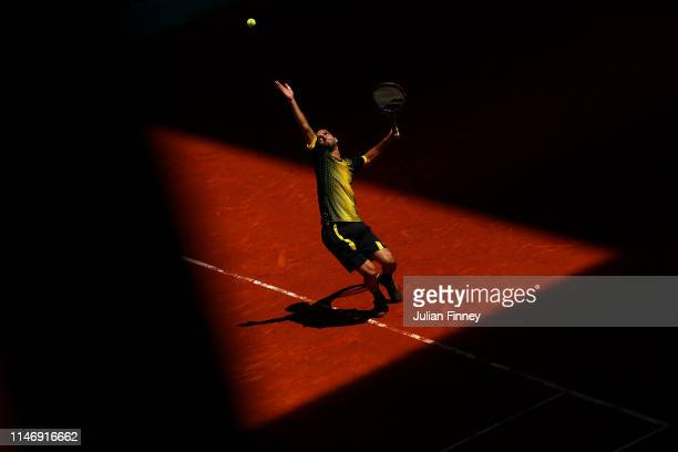 Albert Ramos-Vinolas of Spain serves to Taro Daniel of Japan during day one of the Mutua Madrid Open at La Caja Magica on May 04, 2019 in Madrid,...