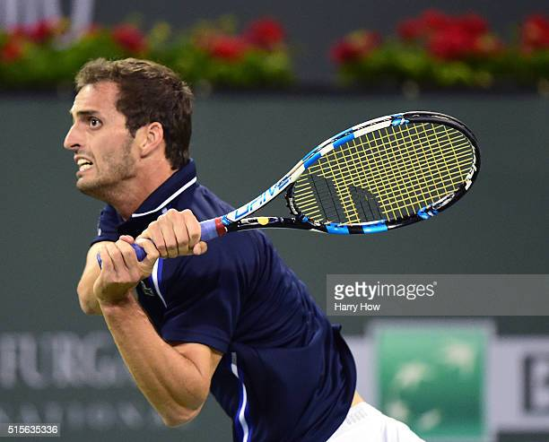 Albert RamosVinolas of Spain watches his backhand during his straight set loss to Gael Monfils of France at Indian Wells Tennis Garden on March 14...