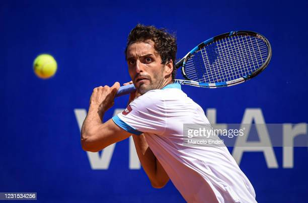 Albert Ramos-Viñolas of Spain hits a backhand during a match against Sumit Nagal of India as part of day 5 of ATP Buenos Aires Argentina Open 2021 at...