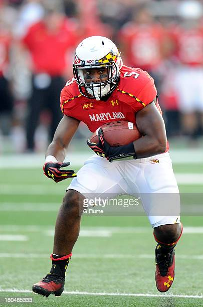 Albert Reid of the Maryland Terrapins rushes the ball against the Old Dominion Monarchs at Byrd Stadium on September 7 2013 in College Park Maryland