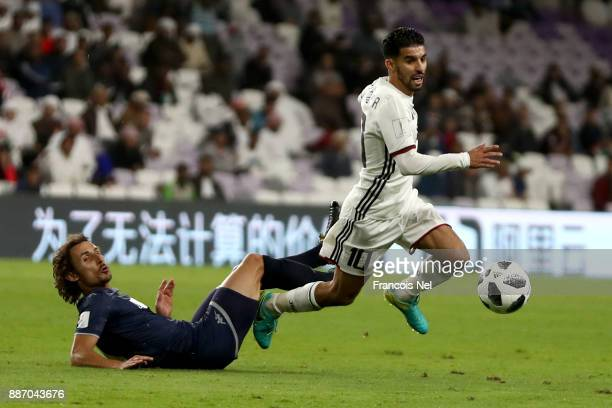 Albert Riera of Auckland City FC fouls Mbark Boussoufa of AlJazira during the FIFA Club World Cup UAE 2017 play off match between Al Jazira and...