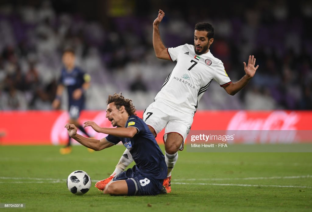 Albert Riera of Auckland City FC is fouled by Ali Mabkhout of Al-Jazira during the FIFA Club World Cup UAE 2017 play off match between Al Jazira and Auckland City FC at on December 6, 2017 in Al Ain, United Arab Emirates.