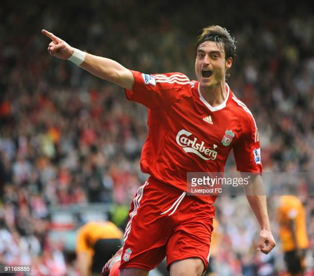 Albert Riera of Liverpool celebrates after scoring the final goal of the Barclays Premier League match between Liverpool and Hull City at Anfield on...