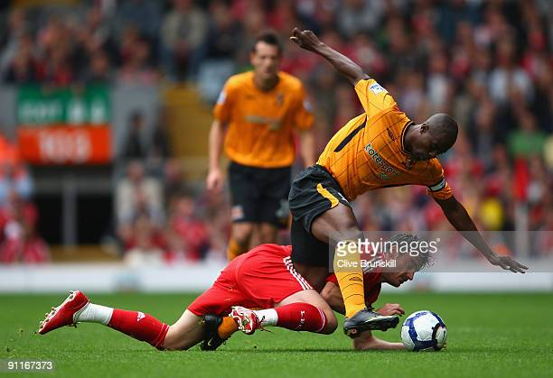 Albert Riera of Liverpool tangles with George Boateng of Hull City during the Barclays Premier League match between Liverpool and Hull City at...