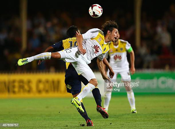 Albert Riera of the Phoenix competes with Marcos Flores of the Mariners for a header during the round six ALeague match between the Central Coast...