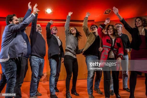 Albert Rivera head of Ciudadanos center left and Ines Arrimadas head of Ciudadadanos in the Catalan Parliament center right celebrate on stage during...