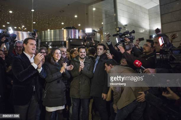 Albert Rivera leader of Ciudadanos left and Ines Arrimadas a member of Ciudadanos second left pose for the media in front of the party's headquarters...