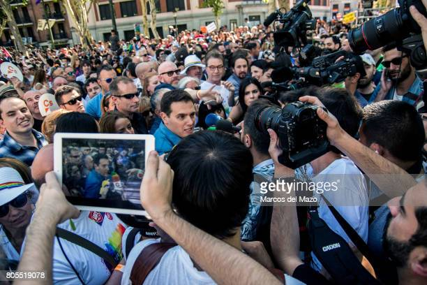 Albert Rivera leader of Ciudadanos Party interviewed by the press during the demonstration of the WorldPride 2017 Behind him Pablo Iglesias leader of...
