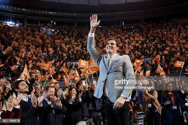 Albert Rivera leader of Ciudadanos wave his hand to his supporters as he stands on a chair during a campaign rally at Palacio de Vistalegre on...