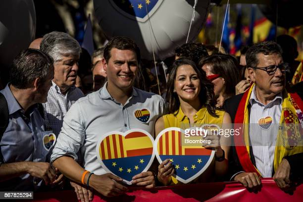 Albert Rivera leader of Ciudadanos party center left and Ines Arrimadas leader of Ciutandans in Catalonia hold heartshaped design placards featuring...