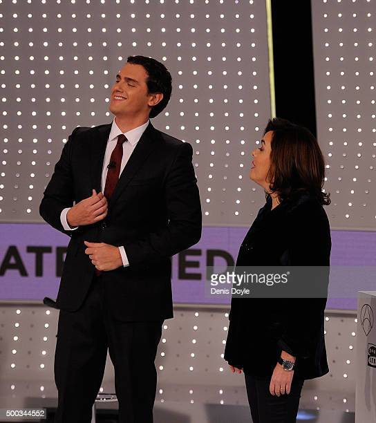 Albert Rivera of Ciudadanos party looks up beside VicePresident Soraya Saenz de Santamaria of the ruling Popular Party before their television debate...