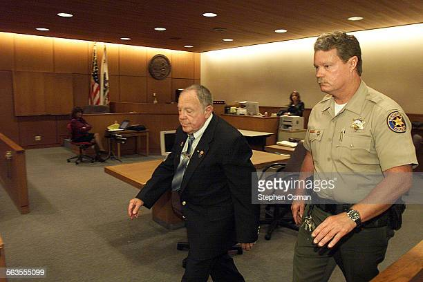 Albert Rosen left is taken into custody after being sentenced to 1 year to life on each of 9 counts of child molestation The molestation took place...