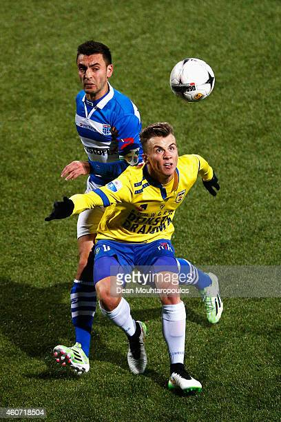 Albert Rusnak of Cambuur and Bram van Polen of Zwolle battle for the ball during the Dutch Eredivisie match between SC Cambuur and PEC Zwolle at...