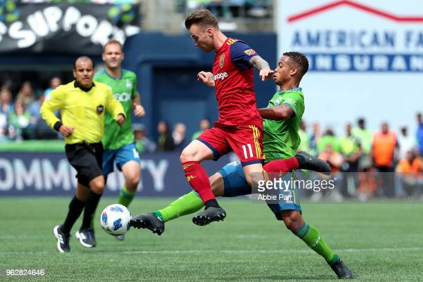Albert Rusnak of Real Salt Lake and Jordy Delem of Seattle Sounders fight for the ball in the first half during their game at CenturyLink Field on...
