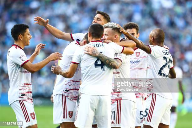 Albert Rusnak of Real Salt Lake is congratulated by his teammates after scoring a goal in the first half against Minnesota United during the game at...