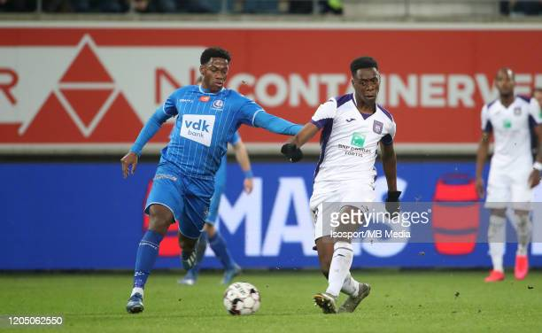 Albert Sambi Lokonga of Anderlecht battles for the ball with Jonathan David of Kaa Gent during the Jupiler Pro League match between KAA Gent and RSC...