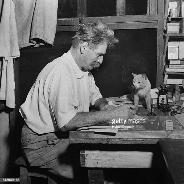 Albert Schweitzer Writing at a Desk