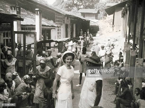 Albert Schweitzer's medical mission in Lambarene equatorial Africa Nurse Albertina with orderly and group of patients waiting for treatment