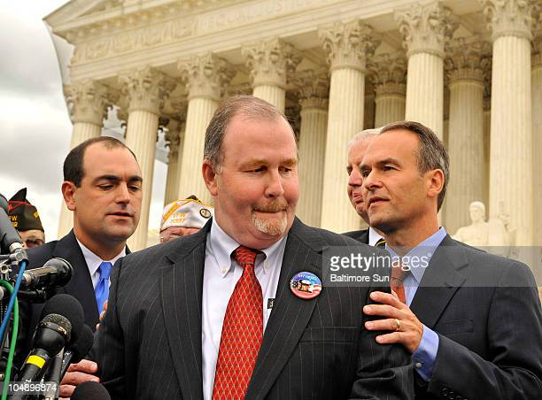 Albert Snyder, center, supported by his attorney, Sean Summers, left, and Kansas City Attorney General Steve Six, right, speak to the media after...