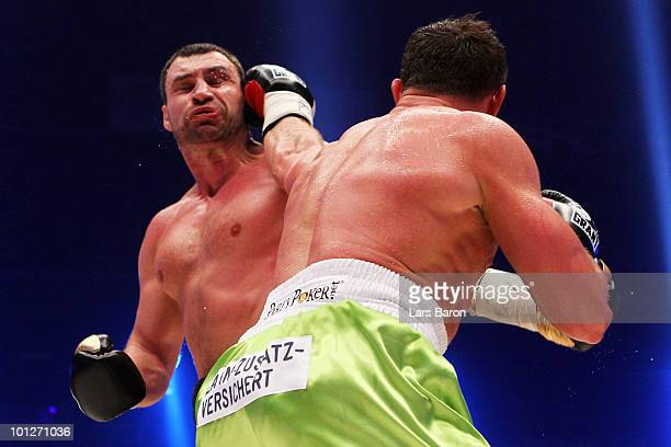 Albert Sosnowski of Poland hits Vitali Klitschko of Ukraine during the WBC Heavyweight World Championship fight between Vitali Klitschko of Ukraine...