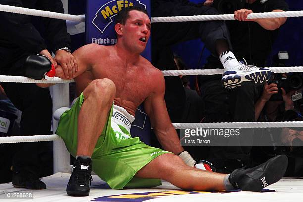 Albert Sosnowski of Poland sits on the ground after loosing the WBC Heavyweight World Championship fight between Vitali Klitschko of Ukraine and...