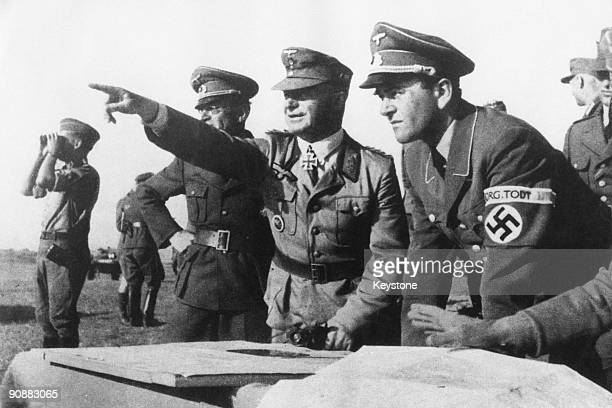 Albert Speer German Minister of Armaments and War Production for the Third Reich with officers of the Organisation Todt military engineering group on...