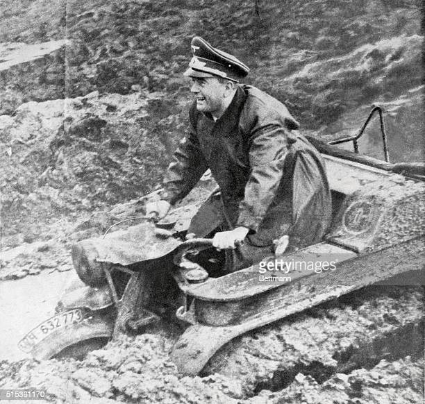Albert Speer Nazi Minister for Armament and Munitions is the pleased looking test pilot of this new German 'Tractorcycle' designed to make the Nazi...