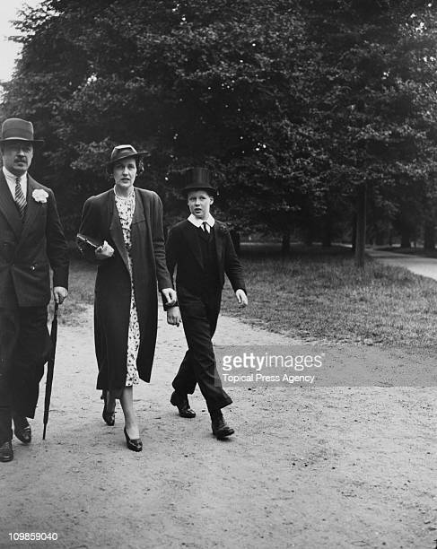 Albert Spencer 7th Earl Spencer with his wife Cynthia and their son Edward John Spencer at Eton College 4th June 1937 John would grow up to father...