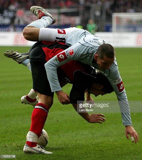 Albert Streit of Frankfurt in action with Leon Andraesens of Mainz during the Bundesliga match between Eintracht Frankfurt and FSV Mainz 05 at the...