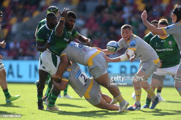Albert Tuisue of London Irish loses the ball in a double tackle by Sione Vailanu and Gabriel Oghre of Wasps during the Gallagher Premiership Rugby...