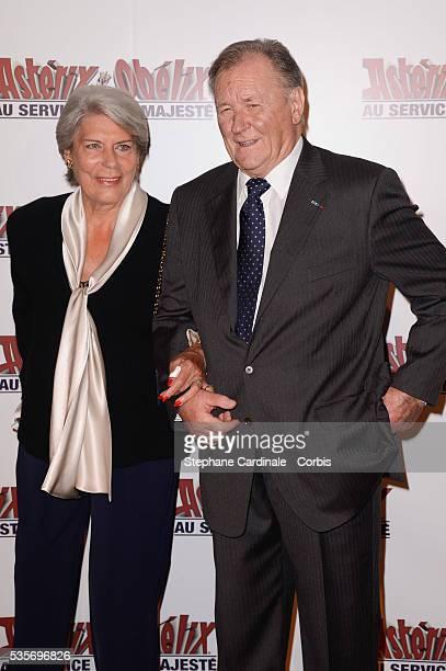 Albert Uderzo and his wife Ada attend the premiere of Asterix Obelix Au Service De Sa Majeste at Le Grand Rex Cinema in Paris