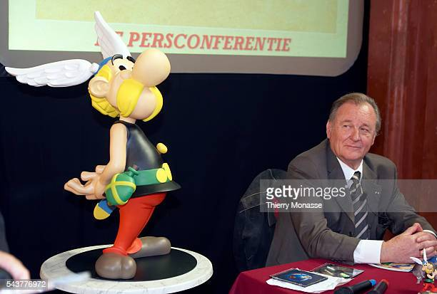 Albert Uderzo cartoon artist of all 33 Asterix comic books and story writer of the last 9 books sits next to a model of Asterix at a news conference...