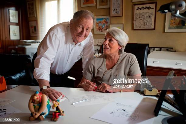 Albert Uderzo French author and illustrator who launched the Asterix comics strip character in 1959 with author Rene Goscinny speaks with his wife...