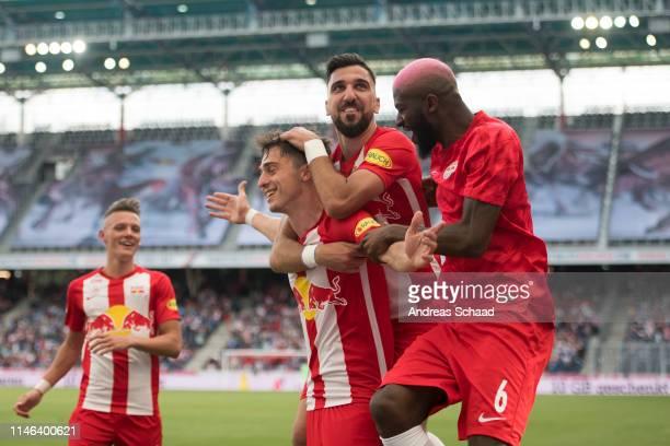 Albert Vallci of Salzburg celebrates with his teammate Munas Dabbur and Jerome Onuguene after scoring on the goal for 20 during the tipico Bundesliga...