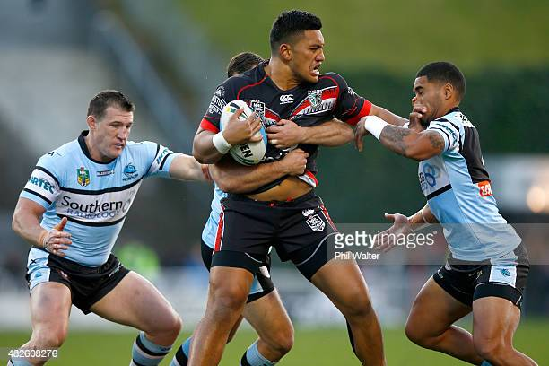 Albert Vete of the Warriors fends off Ricky Leutele of the Sharks during the round 21 NRL match between the New Zealand Warriors and the Cronulla...