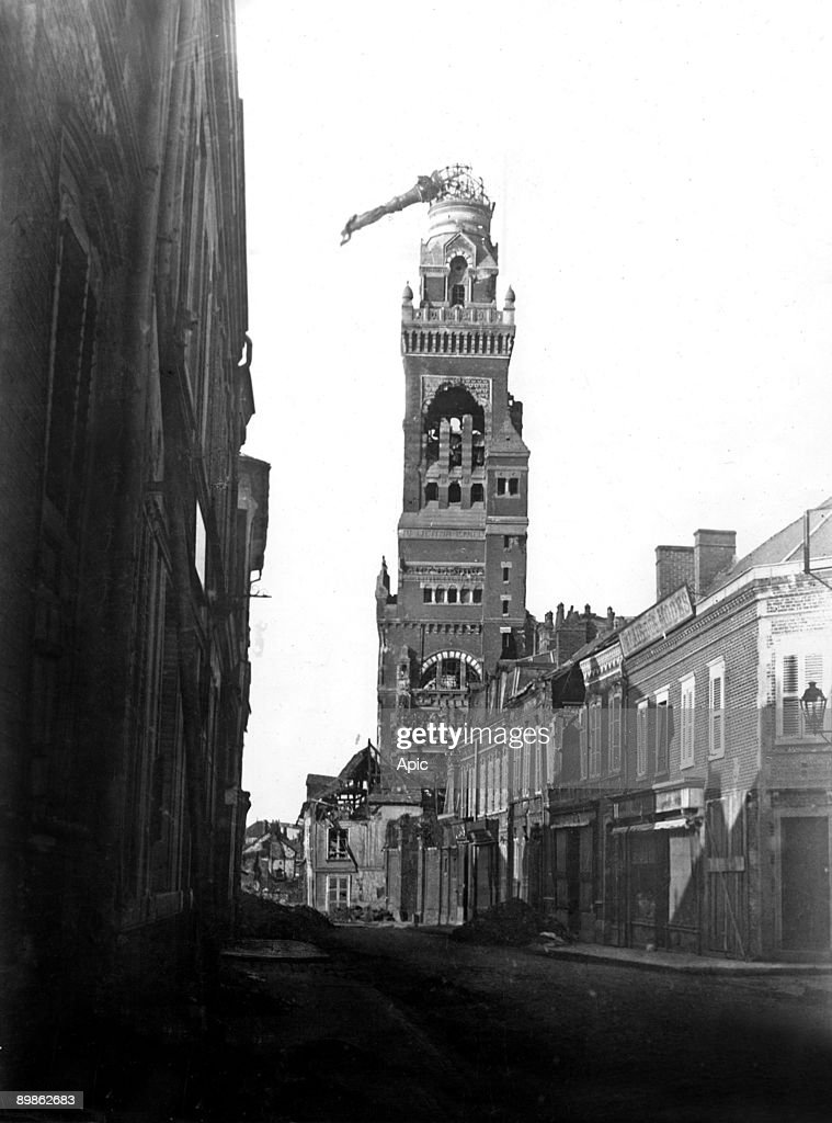 Albert (Somme, France) : view of the basilica with tiltd statue of the Virgin because of a shell in 1915 : News Photo
