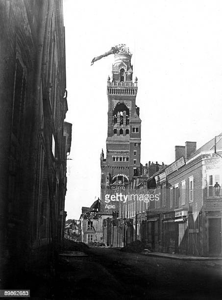 Albert view of the basilica with tiltd statue of the Virgin because of a shell in 1915