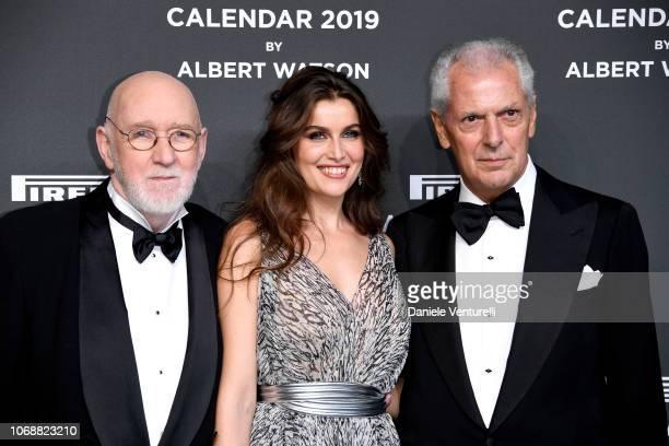 Albert Watson, Isabeli Fontana and Marco Tronchetti Provera walks the red carpet ahead of the 2019 Pirelli Calendar launch gala at HangarBicocca on...