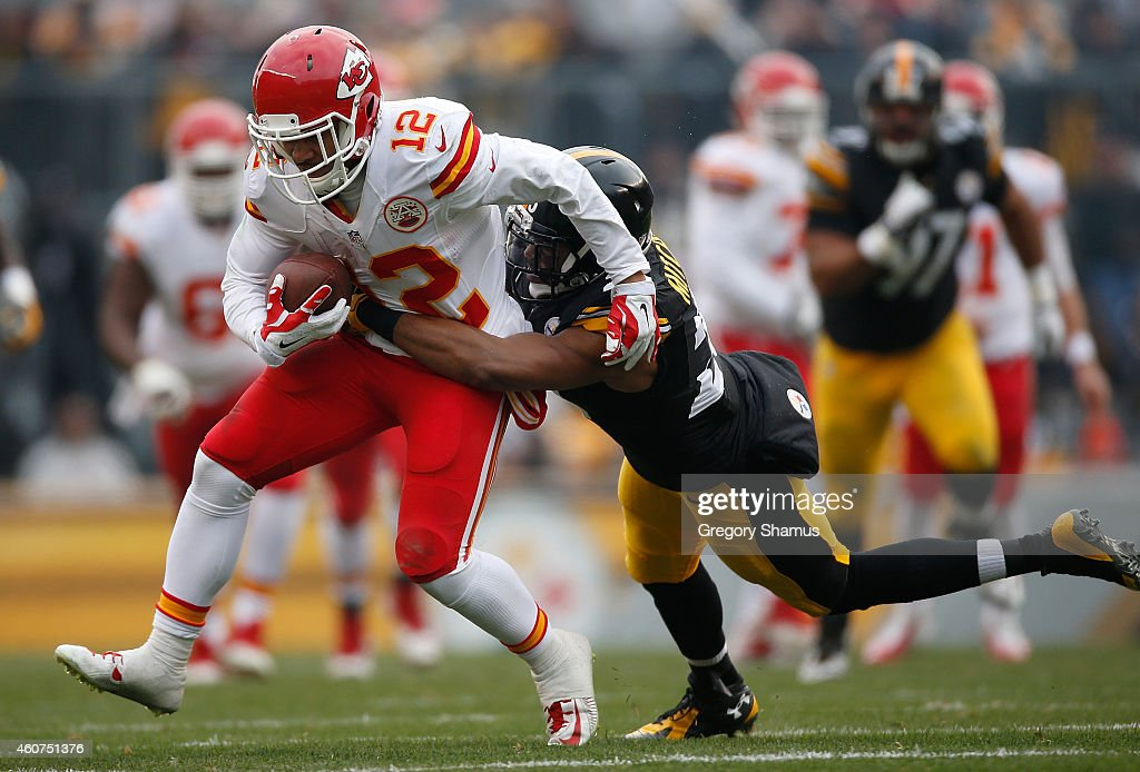Albert Wilson #12 of the Kansas City Chiefs gets wrapped up by Mike Mitchell #23 of the Pittsburgh Steelers during the second quarter at Heinz Field on December 21, 2014 in Pittsburgh, Pennsylvania.