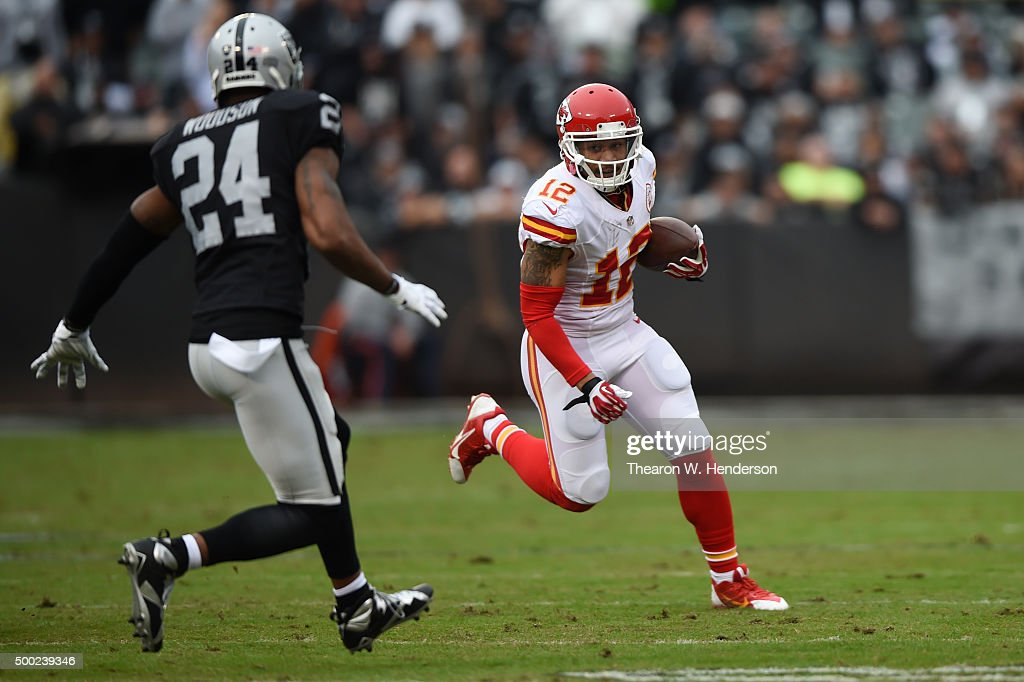 Albert Wilson #12 of the Kansas City Chiefs runs with the ball against Charles Woodson #24 of the Oakland Raiders during their NFL game at O.co Coliseum on December 6, 2015 in Oakland, California.