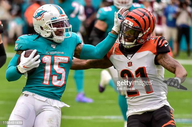 Albert Wilson of the Miami Dolphins avoids being tackled by Darqueze Dennard of the Cincinnati Bengals during the second quarter of the game at Hard...
