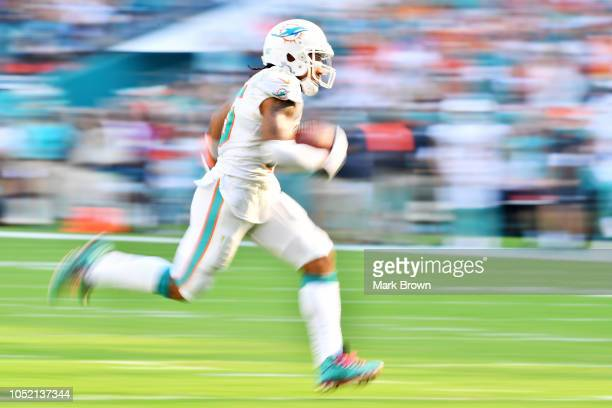 Albert Wilson of the Miami Dolphins carries a pass for a touchdown in the fourth quarter against the Chicago Bears of the game at Hard Rock Stadium...