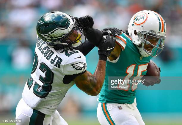 Albert Wilson of the Miami Dolphins stiff arms Rodney McLeod of the Philadelphia Eagles in the second quarter at Hard Rock Stadium on December 01...