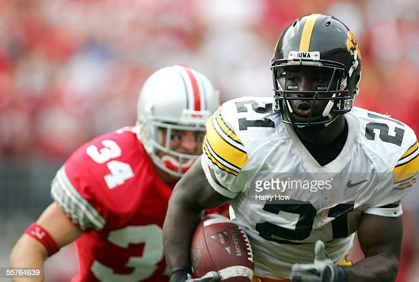 Albert Young of Iowa is chased by Maurice wells of Ohio State during the fourth quarter on September 24 2005 at Ohio Stadium in Columbus Ohio Ohio...