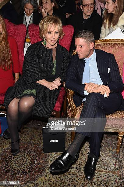 Alberta Ferretti and Lapo Elkann attend the Moschino show during Milan Fashion Week Fall/Winter 2016/17 on February 25 2016 in Milan Italy